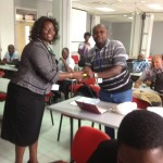 Dr. R. Mangira (left) presenting one of the participants with a gift