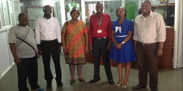 From right  Mr. J. Ngugi, third, University Librarian, Dr. R. Mangira, fifth , Director Mombasa Campus, Dr. Fridah Simba  with staff from the Campus on a mission to receive books donated by Books for Africa