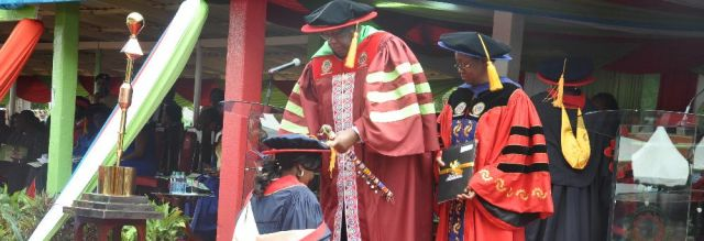 The Chancellor, Prof. Geoffrey Moriaso Ole Maloiy confers a desgree on a graduand as the VC, Prof. Mabel Imbuga looks on.