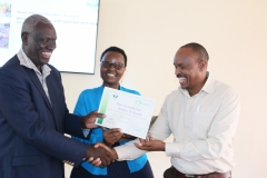 Mr.-Kariuki-of-JKUAT-receives-his-certificate-from-Dr.-RuguttLeft-and-Dr.-Margaret-Karembu-of-ISAAA.